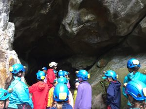The younger group coming out of the caves